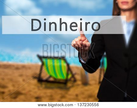 Dinheiro (money In Portuguese) - Business Woman Point Finger On Push Touch Screen And Pressing Digit