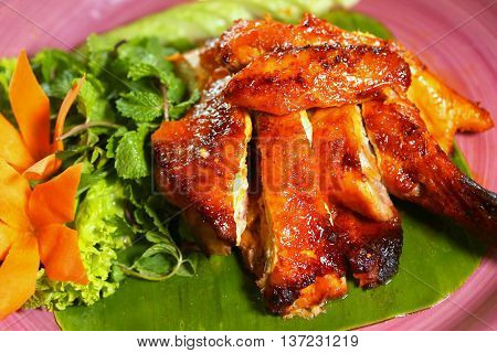 Vietnamese grilled local chicken with honey sauce