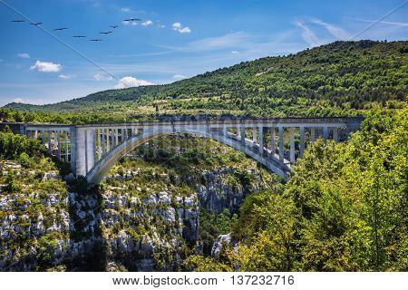The largest alpine canyon Verdon. The white bridge over tributary of the river Verdon Artuby. Verdon, Provence, France