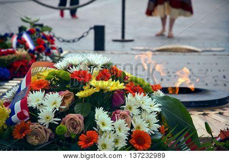The eternal flame at the Arc de Triomphe of Paris