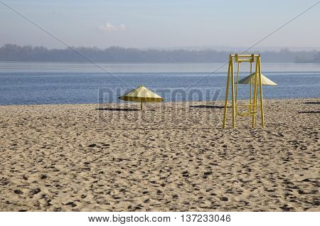Landscape with deserted sandy beach on the river bank