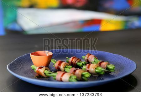 Rolls of pork and haricot or phaseolus vulgaris