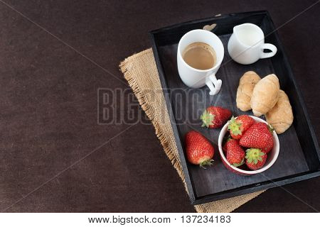 Coffee, Mini French Pastries And Strawberries On Wooden Tray Over Black Table. Black Background