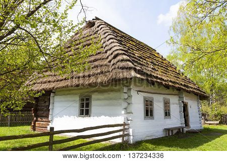 old traditional wooden polish cottage in open-air museum Ethnographic Park Kolbuszowa Poland
