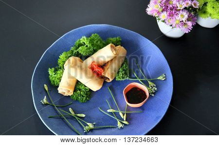 Vietnamese spring rolls on blue dish that serving in the restaurant