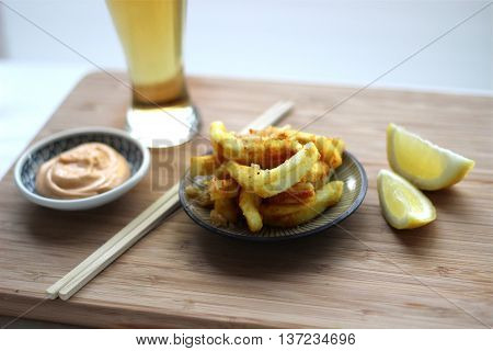 Fried squid on the cutting board that serving in the restaurant