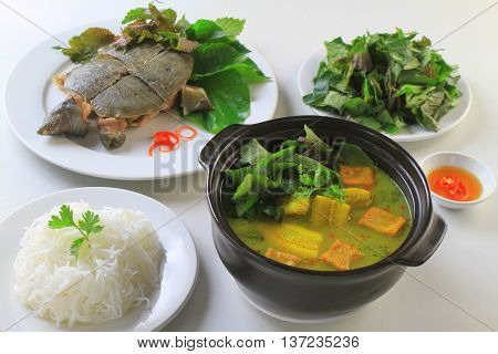 Stewed turtle softshells with herbs banana soup and vermicelli