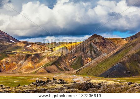 National Park Landmannalaugar. Multicolored rhyolite mountains of the July sun lit. Travel to Iceland in the summer
