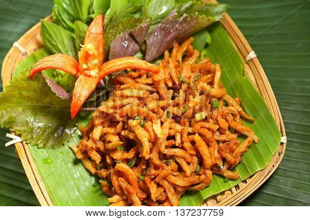 Vietnamese deep fried baby fish on tray of banana leaf