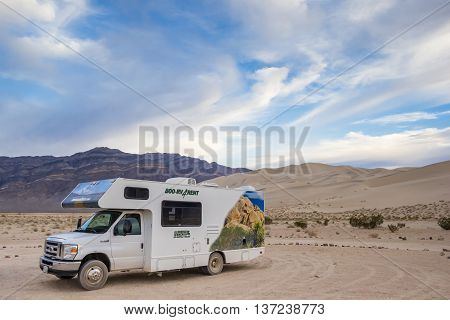 DEATH VALLEY, USA - OCTOBER 15, 2015: RV at the sand dunes in Death Valley National Park