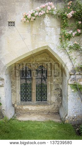 LACOCK ABBEY, LACOCK, WILTSHIRE, UK, 21 JUNE 2016 - Unusual shaped medieval window at Lacock Abbey Lacock Wiltshire UK