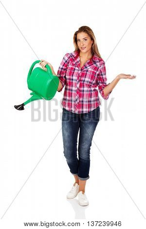Happy woman holding a watering can