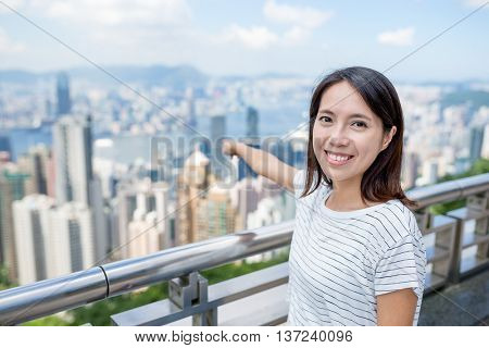 Woman finger pointing to the destination in Hong Kong