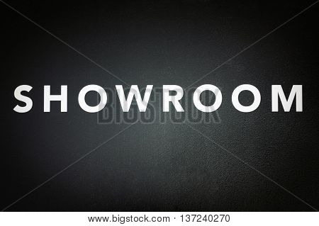 showroom - white text on black door