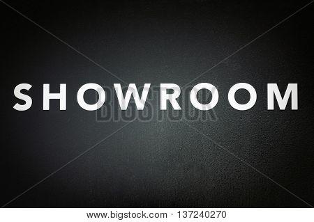 showroom - white text on black door