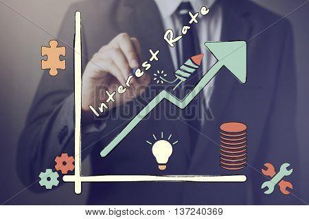 Businessman Drawing Increasing Diagram Of Interest Rate.