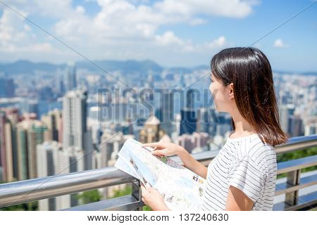 Young Woman travel in Hong Kong city with city map