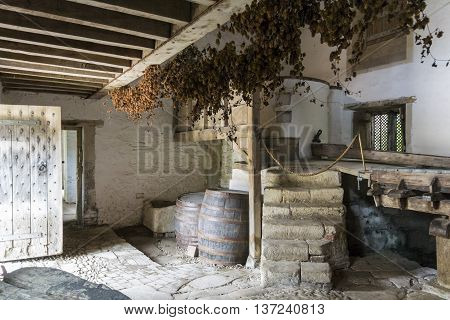 LACOCK ABBEY, LACOCK, WILTSHIRE, UK, 21 JUNE 2016 - Inside the medieval brewery at Lacock Abbey Lacock Wiltshire