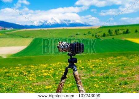 Camera On A Tripod In The Beautiful Landscape Of Spring Snow Mou