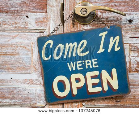 Come In We're Open on the wooden door retro vintage style