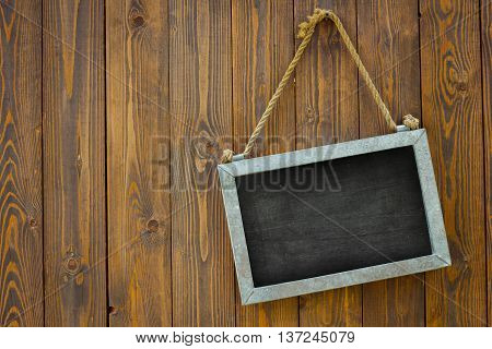white space blackboard with rope on wooden door of a coffee shop. Copyspace on the left. Isolated. Clipping path