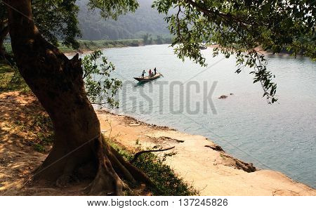 QUANG BINH, Vietnam, May 21, 2016 group of rural people Quang Binh, Vietnam, through the Son river by small boat