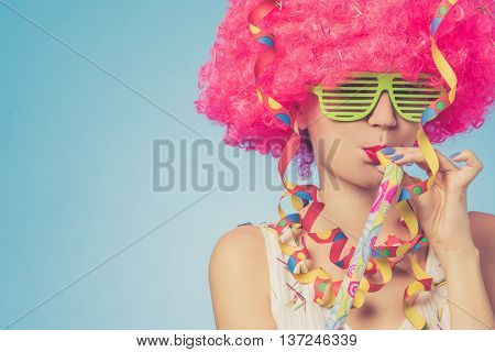 Portrait of beautiful woman in pink wig and green glasses