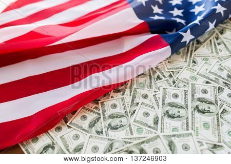 state budget, finance and nationalism concept - close up of american flag and dollar cash money
