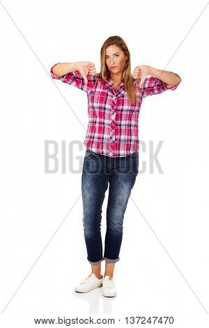 Young unhappy woman with thumbs down