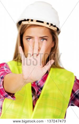 Worker woman making stop sign