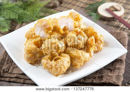 Traditional chinese plate of fried breaded squids on the table in restaurant