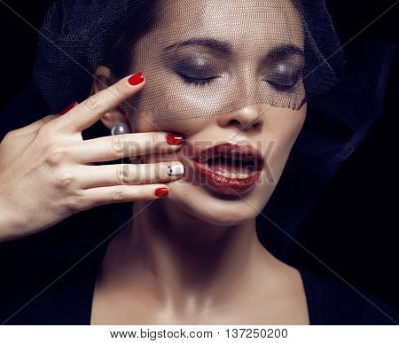 beauty brunette woman under black veil with red manicure close up, grieving widow, halloween makeup