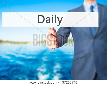 Daily - Businessman Hand Holding Sign