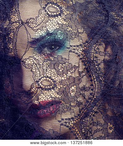 portrait of beauty young woman through lace close up mistery makeup, stylish fashion lady