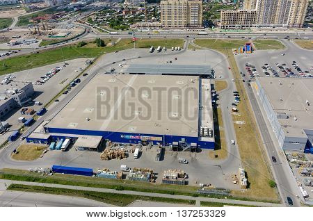 Tyumen, Russia - May 27, 2016: Aerial view onto Metro cash and carry trading center and road construction on Fedyuninskogo and Melnikayte streets intersection