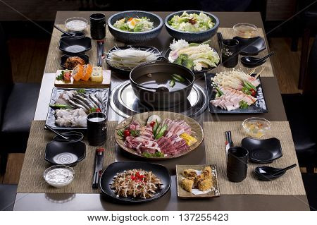 Saigon Vietnam - June 2 2016: A traditional Japanese style of hot pot are being served on the table in a Vietnamese restaurant