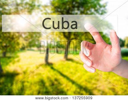 Cuba - Hand Pressing A Button On Blurred Background Concept On Visual Screen.