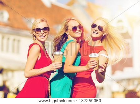 holidays and tourism, friends, blonde girls concept - beautiful women with takeaway coffee cups in the city