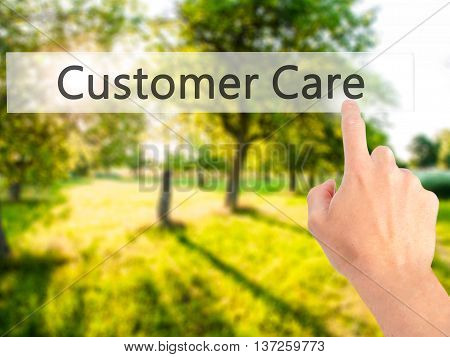 Customer Care - Hand Pressing A Button On Blurred Background Concept On Visual Screen.