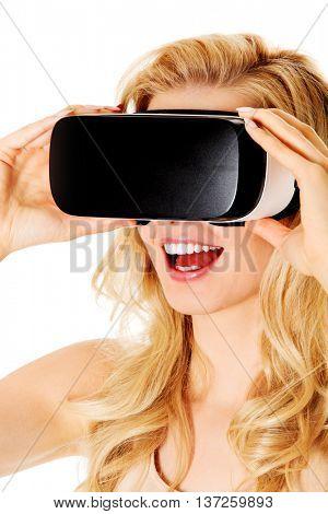 Happy woman wearing virtual reality goggles