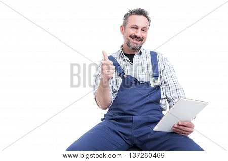 Attractive Smiling Mechanic Showing Thumb Up Gesture