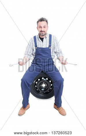 Attractive Mature Repairman On Tire Holding Spanner