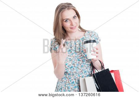 Lucky Shopping Woman With Fingers Crossed Drinking Coffee
