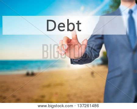Debt - Businessman Hand Pushing Button On Touch Screen