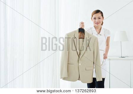 Portrait of pretty maid with fresh clean jacket