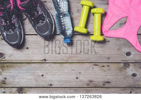 Female fitness accessories on an old wooden table