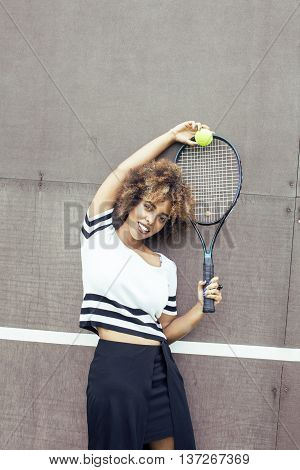 young stylish mulatto afro-american girl playing tennis happy smiling, sport healthy lifestyle people concept