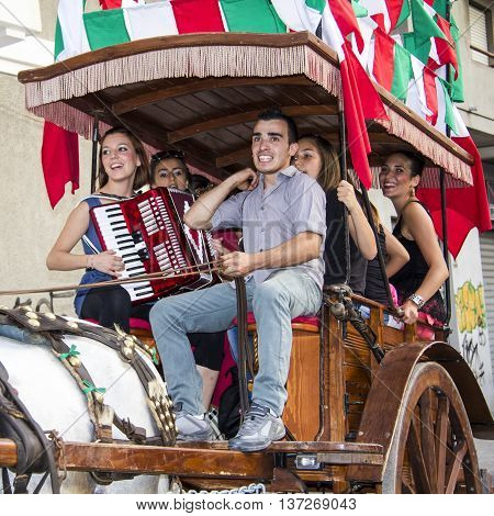 QUARTU S.E., ITALY - July 28, 2012: Feast of St. John - Sardinia - group of young people in a chariot (traccas)