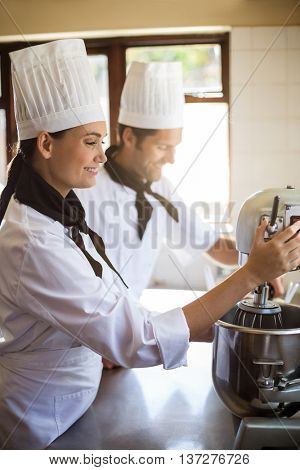 Chef in commercial kitchen blending the batter in mixing blender