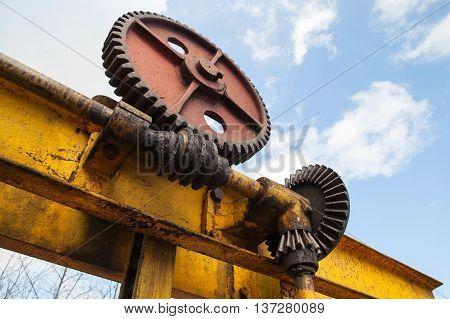 Huge Rusted Gears Engaged With Worm-gear